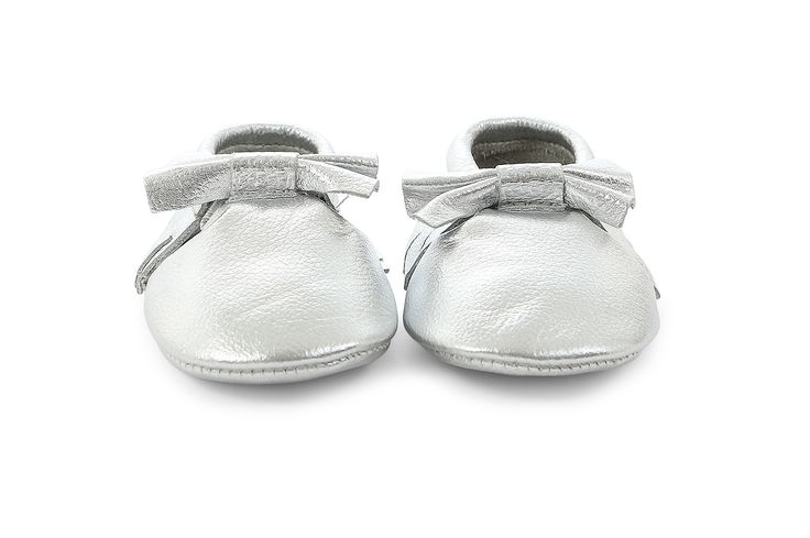 leather moccasins in silver bow