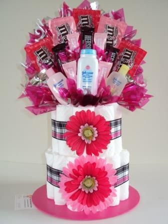 This Diaper Cake looks like a diaper cake and candy bouquet in one....pretty neat!