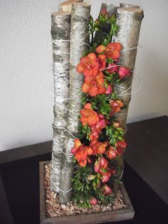 Vertical flower arrangement between branches of birch ~ Willy de Wilde
