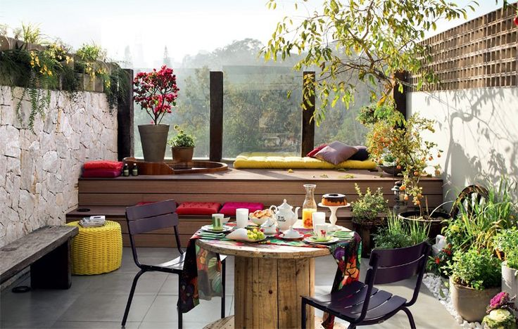 Contrast of materials, glass, stone , wood, water, green plants, very square and modern, intimate seating with a view