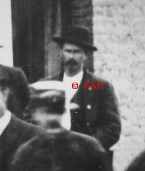 We believe this is Wyatt Earp taken at the dedication of the Tombstone Engine Co. No.1 on Toughnut St. in the summer of 1881. The Tombstone Engine Co. No.1 was founded in 1880 with Wyatt being its first secretary. This is from a photograph taken of the orignal by John D. Gilchriese. We purchased the photo and enlarged this portion of it to reveal Mr. Earp. Wish I knew where the original was! ©Kevin Mulkins, 2012. Early Tombstone Paper.