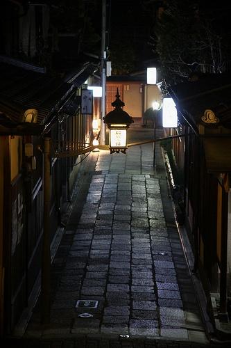 Entrance to Ishibei-koji, an area of Japanese restaurants and Japanese-style inns (ryokan) late at night. Kyoto, Japan.