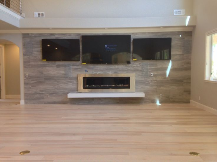 Captivating Caesarstone Blizzard Quartz Hearth Complements Contemporary Fireplace And  Enough Screens To Watch All