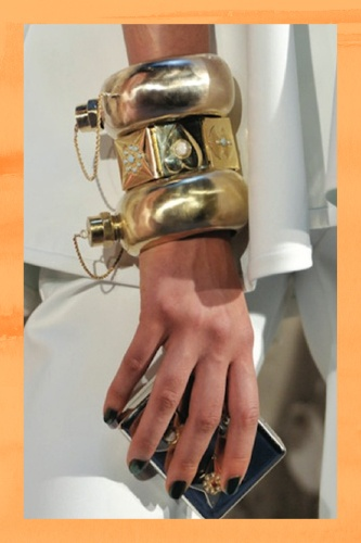 Cynthia Rowley has created the ultimate accessory in the form of a bracelet that doubles as a flask. We'll cheers to that!