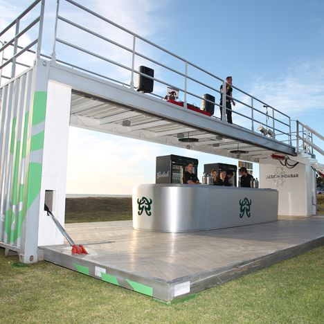 Camps bay, South Africa. Grolsch  beer. Two standard shipping containers transformed into a mobile pop-up bar and art gallery. The Design Indabar is self contained fitted with its own generator enabling it to be set up in unique locations. Transportable to remote locations and stunning design! popuprepublic.com