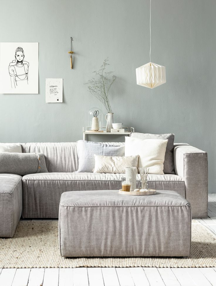 White, grey and light interior / living room with white wooden floors and a grey wall, grey canvas vtwonen couch and foodstool Lazy, paper lamp, natural rug by Zuiver and accessoires by Sukha Amsterdam, All the Luck in the World, Studio Elke van den Berg , H&M Home, Het Kabinet, Bodilson, Six and Sons, The Cherry on Top, Livv Lifestyle and De Oude Plank. | Styling Kim van Rossenberg | Photographer Sjoerd Eickmans | vtwonen May 2015 | #vtwonencollectie