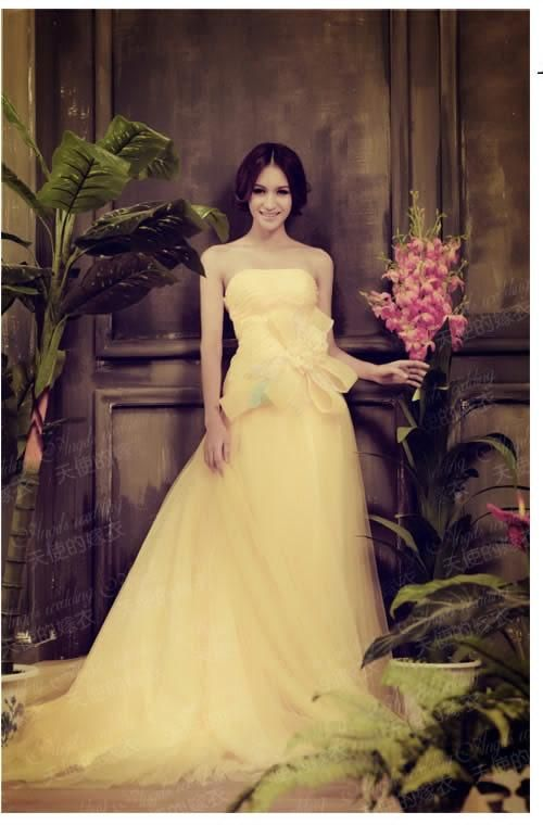 Soft yellow colour wedding gown dresses with low chest for Can a yellowed wedding dress be whitened