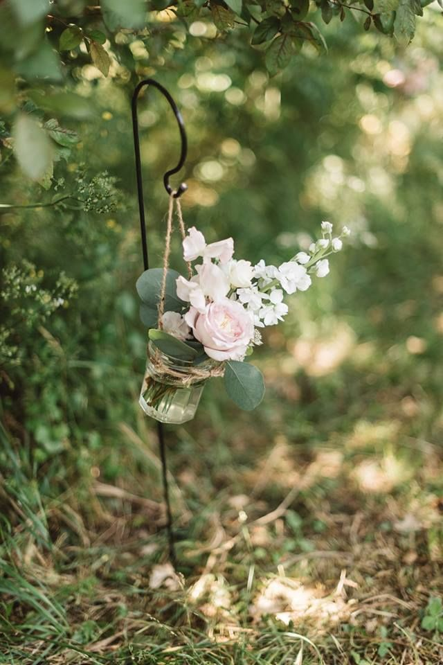 Sweet pea, stock and garden rose jam jars