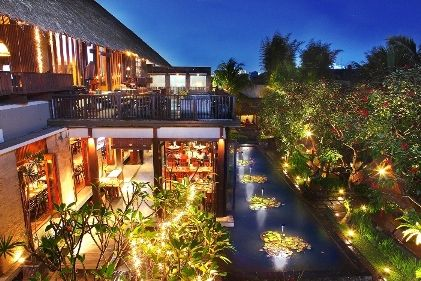 Our natural outdoor area on romantic dawn view. Fish ponds & tropical gardens alongside your table.