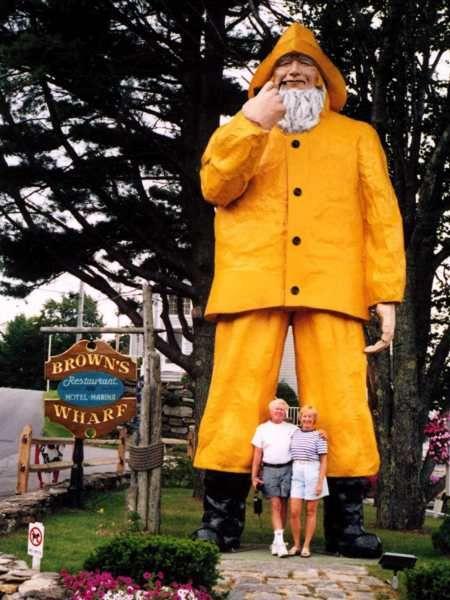 Fisherman in Boothbay Harbor ME in front of Brown's Wharf Restaurant