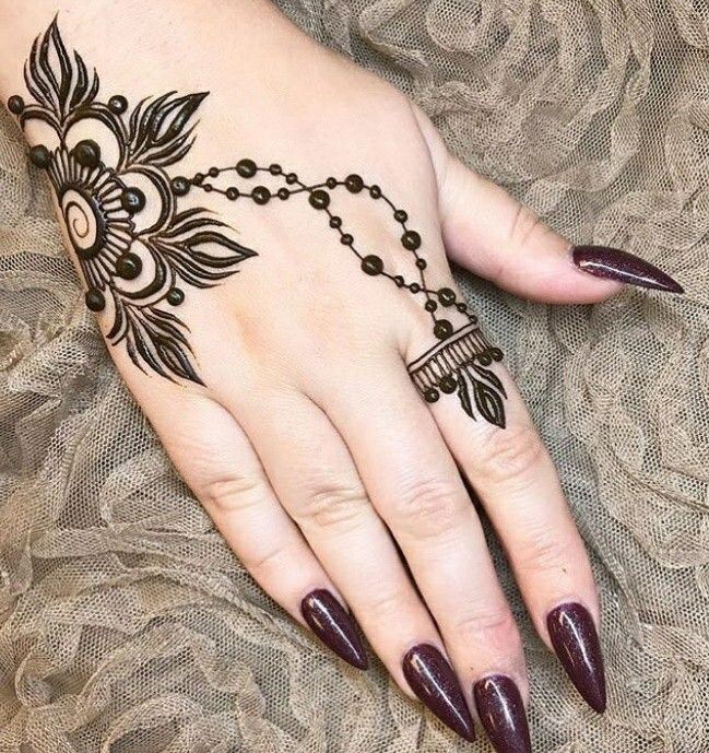 minimal henna design | simple flowery mehndi design on hand | like a ring