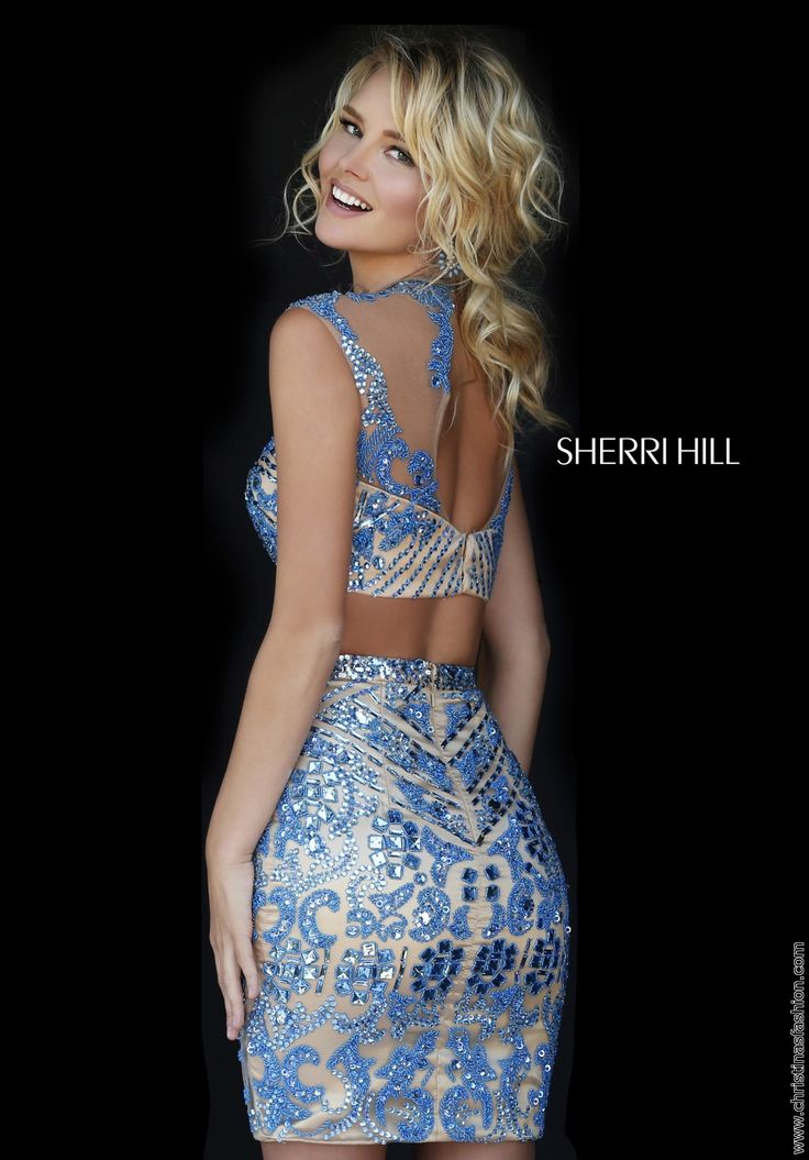 Show off those curves in this sexy and hot Sherri Hill 2 piece all beaded shorty with high illusion neck and a key hole back!