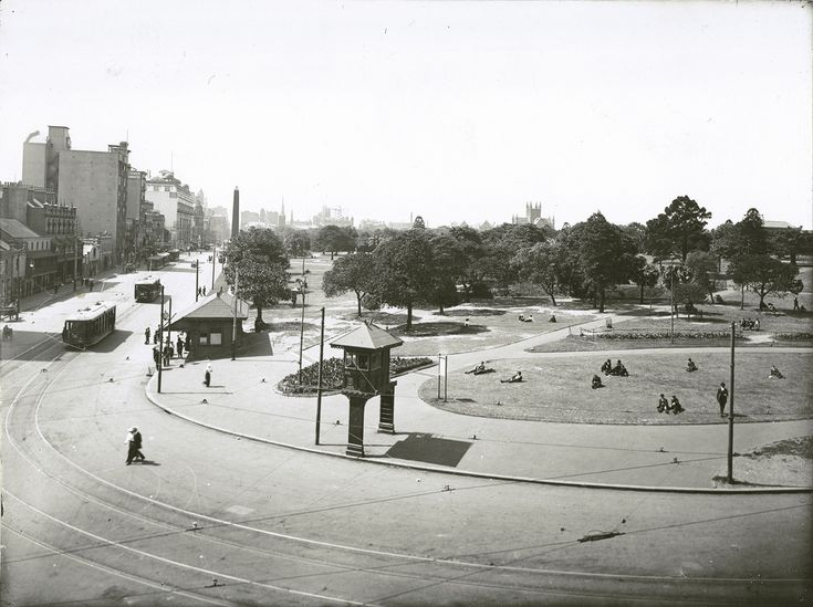 """Hyde Park - south west corner showing site of what is now the entrance to Musuem Railway Station, Sydney Dated: No date Digital ID: 17420_a014_a0140001223 Rights: www.records.nsw.gov.au/about-us/rights-and-permissions  This image is part of our """"Moments in Time"""" blog series where we ask you to help us date the photos or identify the location where the photo was taken. If you can help with this image please head over to the post at our Archives Outside blog. We have included the larger…"""