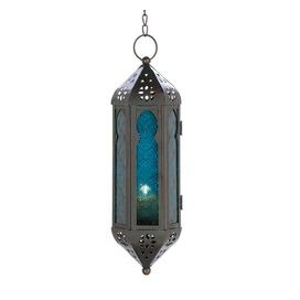"""Hanging Moroccan-style lantern with blue glass panels and cut-out detail.    Product: LanternConstruction Material: Iron and glassColor: Blue and pewterFeatures: Chain includedAccommodates: (1) Candle - not includedDimensions: 20"""" H x 3"""" W x 3.5"""" D"""