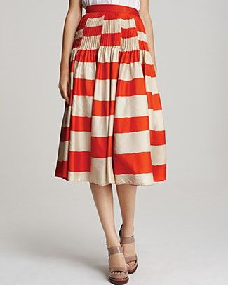 by Marc Jacobs Bella Striped Skirt ($498) with a printed top and bright wedges for a perfectly clashed ensemble.
