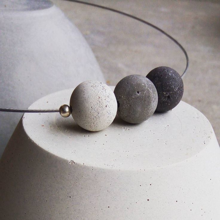 Concrete beads on a minimal style necklace.