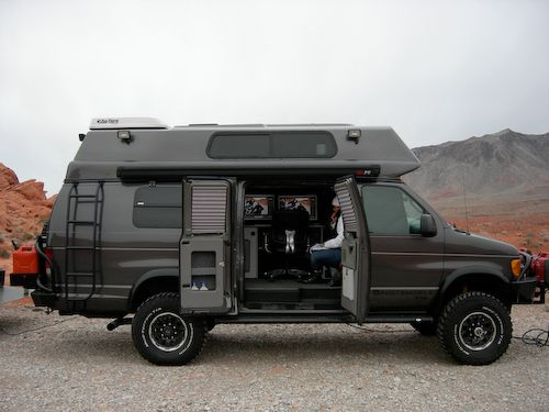 Grey van . voyager top . with Aluminess ladder and rear bumper with swing outs