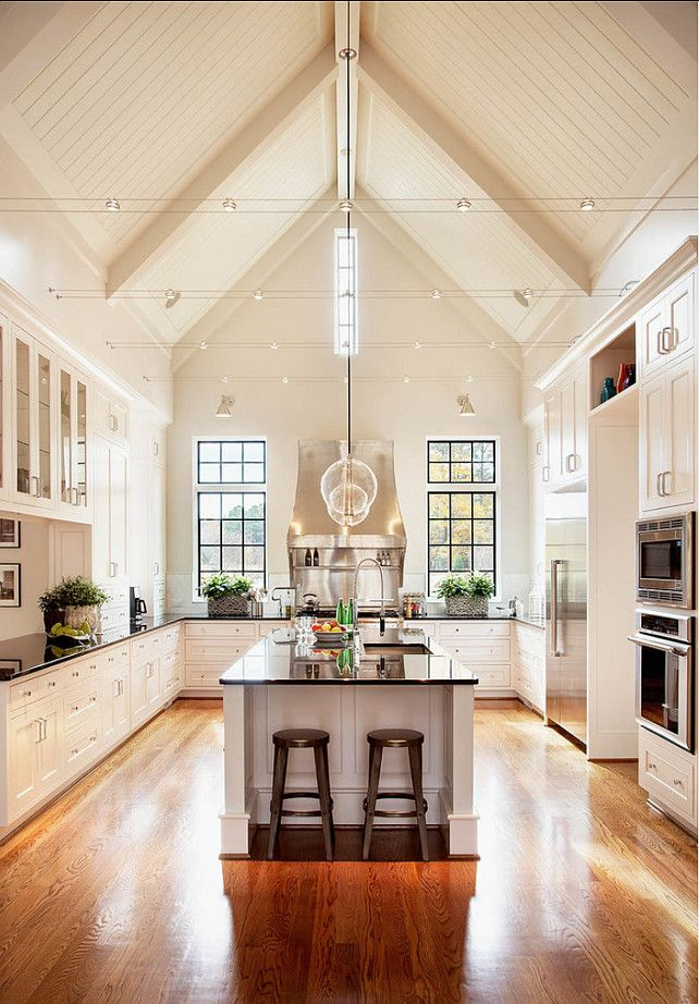 The 'Cathedral' ceiling and cable lighting create a sensational setting for this modern kitchen..