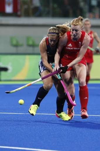 Britain rallies, takes women's field hockey pool from US:  August 13, 2016  -     United States' Katie Bam, left, fights for the ball with Britain's Nicola White during a women's field hockey match at the 2016 Summer Olympics in Rio de Janeiro, Brazil, Saturday, Aug. 13, 2016. (AP Photo/Dario Lopez-Mills)