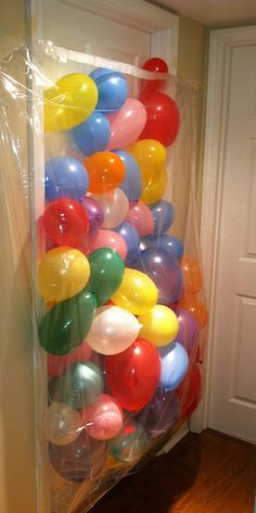 """Birthday balloon avalanche :) What you'll need: -bedroom door that opens inward -clear shower curtain (you could use anything but we chose the clear curtain so we could capture her face on video) -painters tape -75 balloons (we used the small ones and probably """"over did it""""... but she only turns 6 once, right?!) -two out of breath parents -one birthday girl/boy More"""