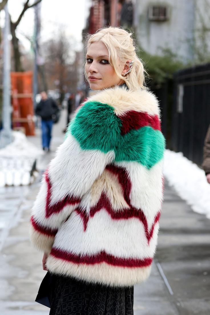 Aline Weber wearing an amazing colorful  fur coat.