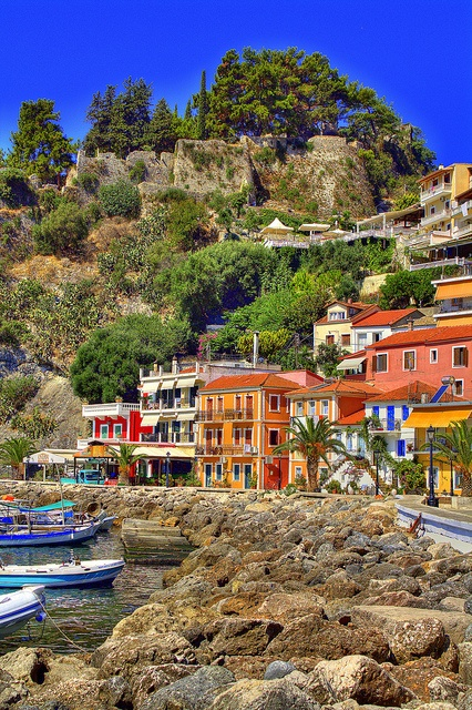 Love the colours and would certainly travel to this beautiful place someday... The village of Parga, Greece