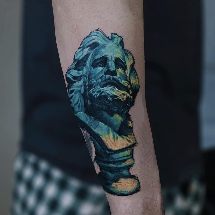 colorful sculpture tattoo idea on the forearm