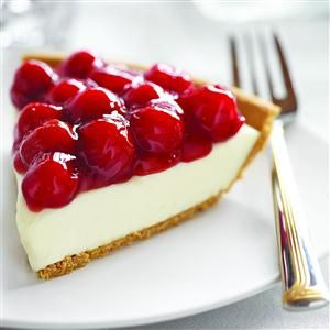Cherry Cream Cheese Pie 1 (8 oz.) package cream cheese, softened 1 (14 oz.) can Eagle Brand® Sweetened Condensed Milk 1/3 cup lemon juice 1 teaspoon vanilla extract 1 (8 or 9-inch) prepared graham cracker or baked pie crust 1 (21 oz.) can cherry pie filling, chilled