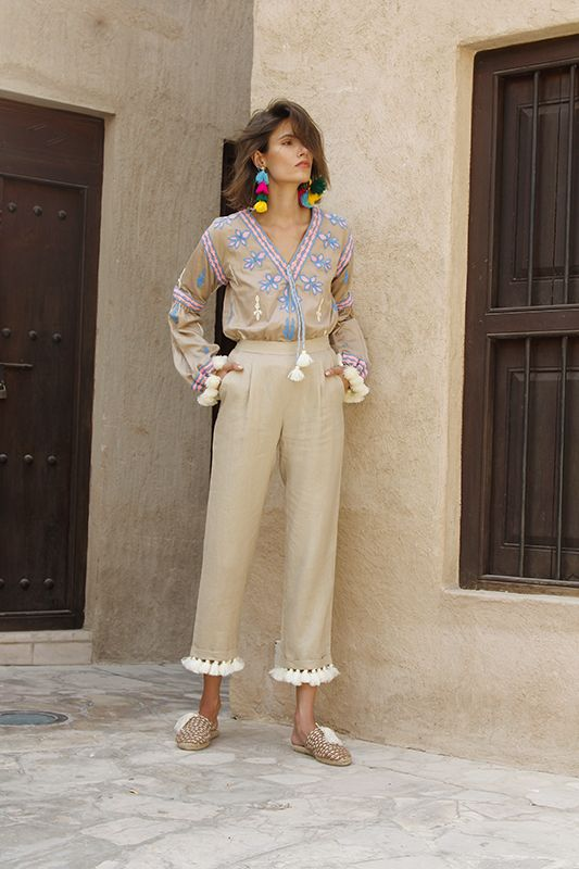 Pom pom adorned knit bombers, wool shag espadrilles and tassel trimmed everything?! Mochi designer Ayah Tabari is, once again, speaking my language with her spring collection. This season, the Palestinian designer has moved from the motifs of Uzbekistan and onto the warm desert hues and pops of