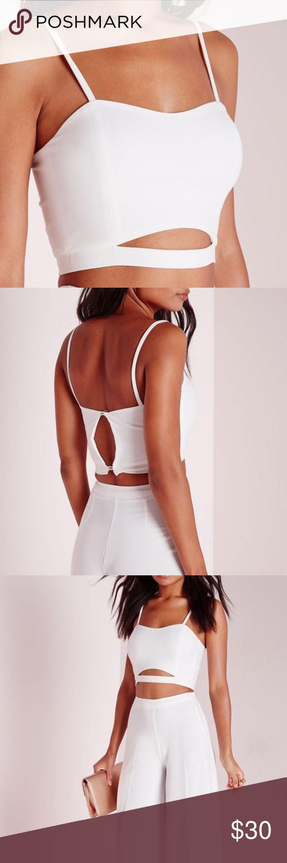 Missguided White Crepe Crop Top NWT Never worn! Cute crepe white crop top from Missguided-$33 on the site and sold out in most sizes! New with tags! Doesn't fit me (I bought the wrong size) I'm usually a 4-6 and the 8 is big but seems like it would fit a normal 8 or a bigger cup size! Missguided Tops Crop Tops