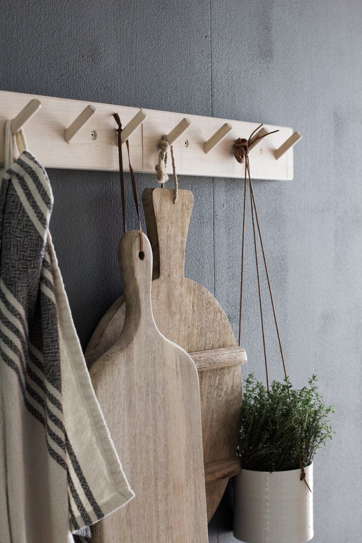 my scandinavian home: My kitchen update: wooden hooks. photography- Niki Brantmark. Styling Genevieve Jorn