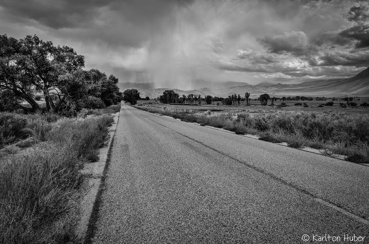 "www.karltonhuberphotography.com posted a photo:  Owens Valley - Distant Downpour. ©Copyright 2017 Karlton Huber Photography - all rights reserved.  Each time I visit the Eastern Sierra and Owens Valley I always make it a point to find a reason to ask myself ""I wonder what's down there?"" Then proceed to explore a new road, trail or path and go find out.  On this day, after exploring a new (to me) rather bumpy dirt road that wiggled up into a shadow filled ravine I learned that ""not much"" was…"