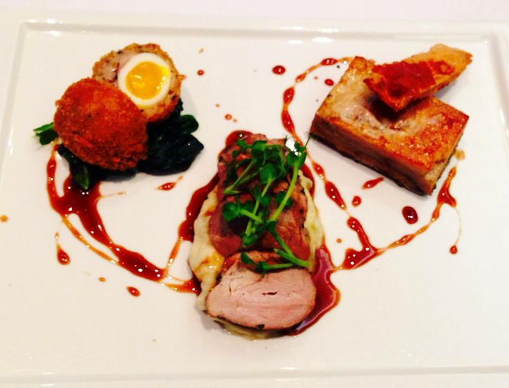 Trio of pork– grilled fillet with crackling, slow cooked belly and a mini Scotch egg with apple mash and cider jus