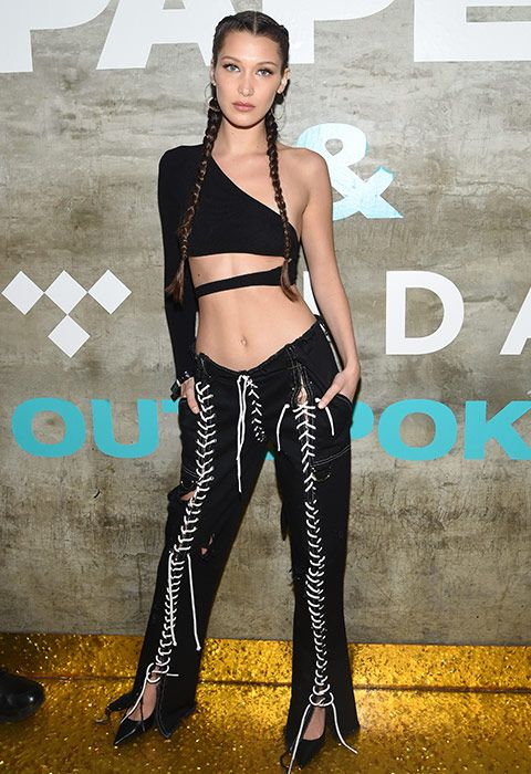 Warning: not one for dinner out with the girls, but Bella Hadid gave us serious inspo with her Christina Aguilera circa Dirrty outfit. A statement one-shoulder top with side cut-outs were paired with lace-up everywhere trousers and pointed black heels