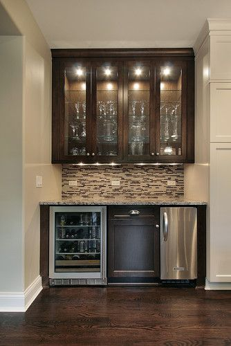 Bar area and wine storage would be nice to have as part of the kitchen/family room design. Like the dark wood flooring