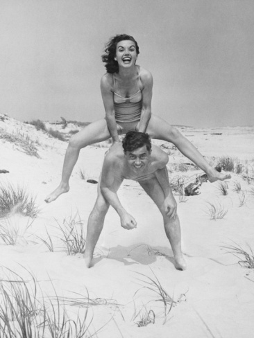 Young Couple on Beach, Woman Leap-Frogging Man, Portrait by George Marks. Photographic print from Art.com.