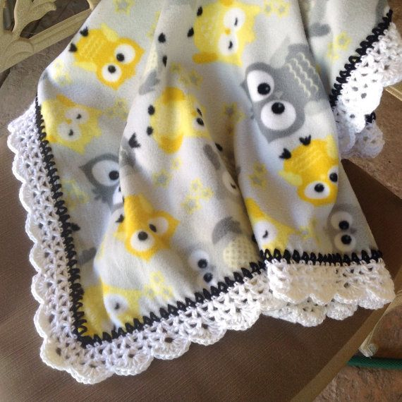 White, Gray and Yellow Owl fleece baby blanket with a Black and white crocheted edging. Blanket measures 32 x 42. This would be perfect for any
