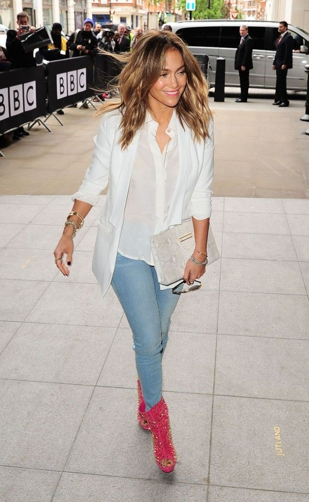 Jennifer Lopez in flowing loose white top and red boots! Statement it is!