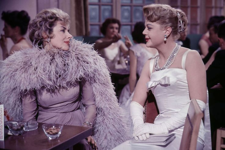 A drawing-room comedy about the last group of debutantes to be presented to the Queen at court before the ritual was abandoned, Kay Kendall starred as the permanently ostrich-feather-clad Sheila along with a young Angela Lansbury. Pierre Balmain made the clothes - and he couldn't have done a more fabulous job.