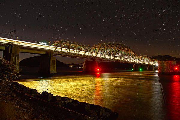 Hawkesbury river railway bridge, night lights of a train :)