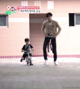 a baby and a giant riding their bikes #Jongin #Taeoh