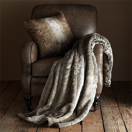 the ultimate in comfort and convenience, our faux fur grey wolf throw dresses any living space with a touch of lavishness. whether strategically drape