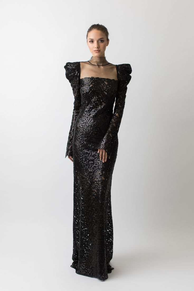 Black sequin puff shoulder, full sleeve gown  This black gown is the perfect dress if you want to make a statement. With its full lenth sleeves and emphasized shoulders this unique dress hits all the right curves with its intricate sequin design and sheer bottom. #evening #embellished #sleeves #sequins #vintage