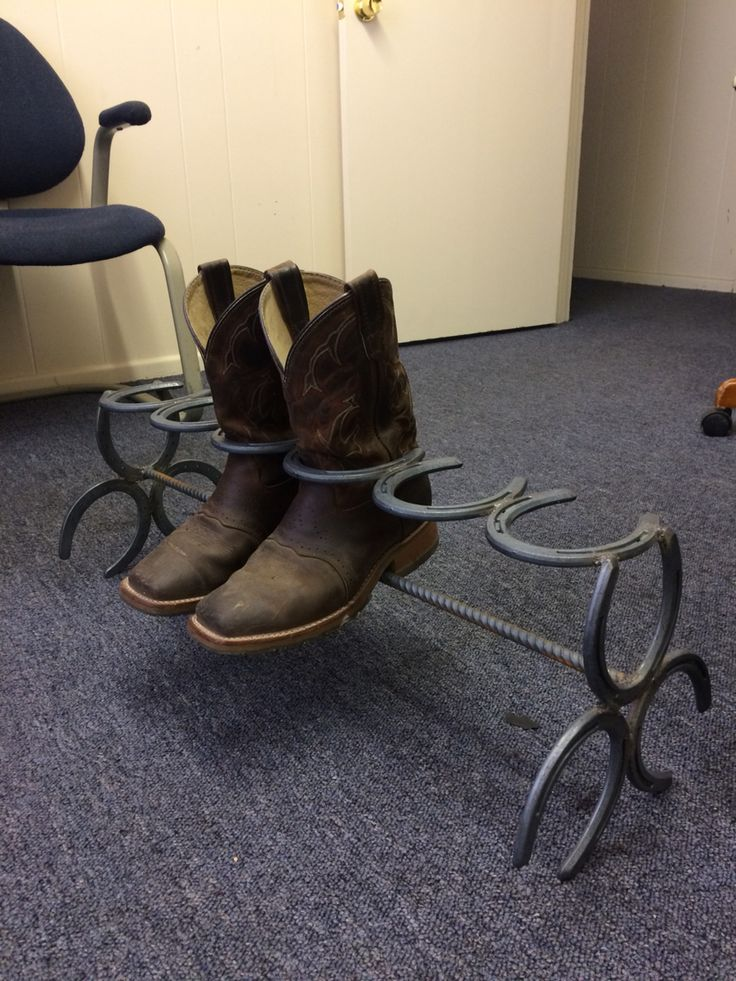 Horseshoe boot rack.