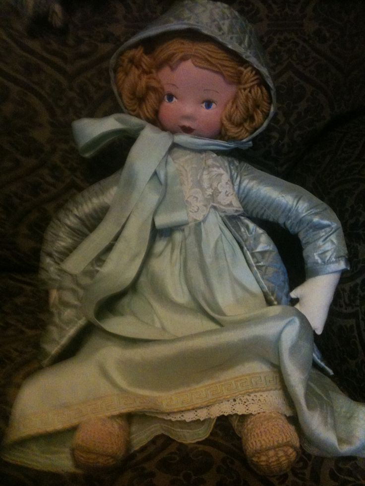 Rag Doll in silk Clothes.