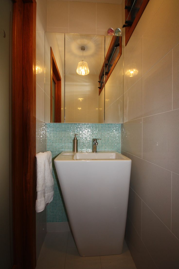 Powder Room, Compact practical design with recessed shaving cabinet for storage.