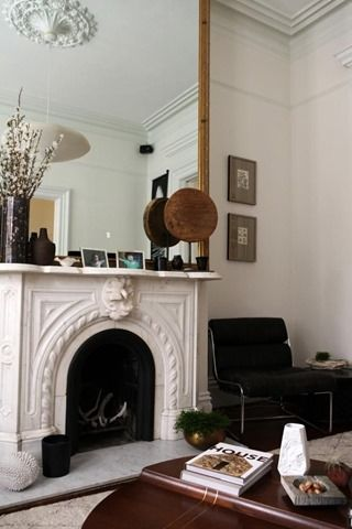 Love the Tall Mirror on the mantel. Might be tough with vaulted ceilings though...