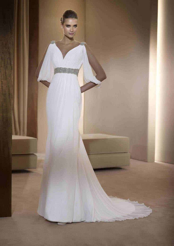This is the perfect gown for a Star Wars themed wedding gown by Pronovias in a Sheath with jeweled detailing.