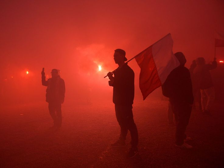 """Polish nationalists light flares in front of the National Stadium during the March of Independence under the slogan """"Poland for the Poles, the Poles for Poland,"""" which is part of Polish Independence Day celebrations in Warsaw. The Independence Day marks the restoration of Poland's independence after 123 years of partitions by Austria-Hungary, Prussia, and Russia, at the end of the First World War on Nov. 11, 1918.  Marcin Obara, european pressphoto agency"""