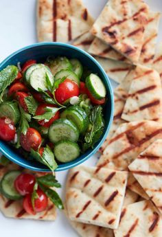 Quite possibly the easiest Cucumber Tomato Salad with Garlic and Herb Grilled Naan from http://www.whatsgabycooking.com (/whatsgabycookin/)